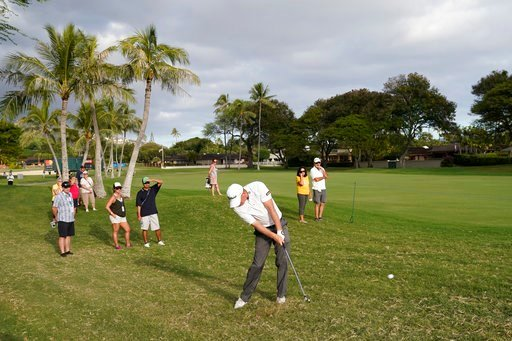 (AP Photo/Marco Garcia). Tom Hoge, center, hits his ball out of the rough back into play on the 16th fairway during the third round of the Sony Open golf tournament, Saturday Jan. 13, 2018, in Honolulu.