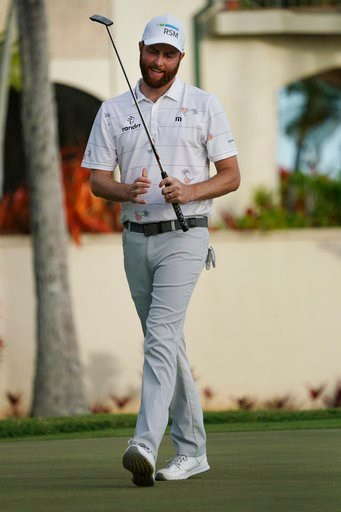 (AP Photo/Marco Garcia). Chris Kirk reacts to his putt on the 16th green during the third round of the Sony Open golf tournament, Saturday Jan. 13, 2018, in Honolulu.