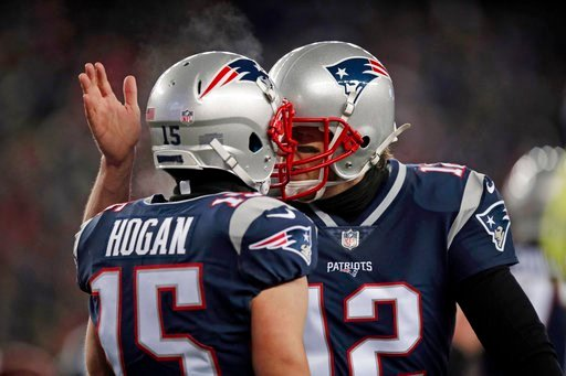 (AP Photo/Charles Krupa). New England Patriots quarterback Tom Brady, right, celebrates his touchdown pass to Chris Hogan during the first half of an NFL divisional playoff football game against the Tennessee Titans, Saturday, Jan. 13, 2018, in Foxboro...