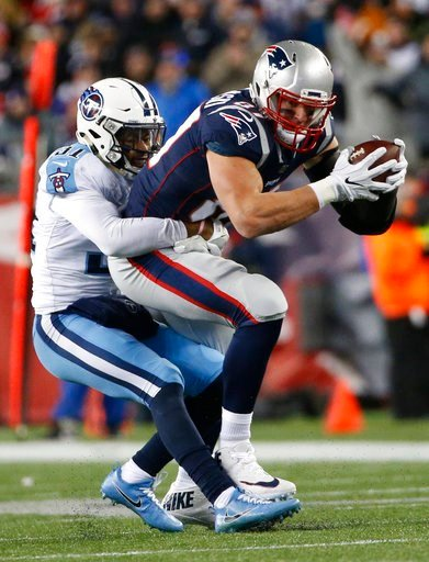 (AP Photo/Michael Dwyer). Tennessee Titans safety Kevin Byard (31) tackles New England Patriots tight end Rob Gronkowski (87) after a reception during the first half of an NFL divisional playoff football game, Saturday, Jan. 13, 2018, in Foxborough, Ma...