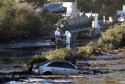 (AP Photo/Marcio Jose Sanchez). Crews pump mud on Highway 101 after a mudslide Saturday, Jan. 13, 2018, in Montecito, Calif.  Most of the people of Montecito, a town usually known for its serenity and luxury, were under orders to stay out of town as ga...