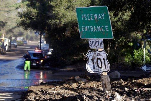 (AP Photo/Marcio Jose Sanchez). A mud-covered sign over the closed Highway 101 is seen at an overpass Saturday, Jan. 13, 2018, in Montecito, Calif.  Most of the people of Montecito, a town usually known for its serenity and luxury, were under orders to...