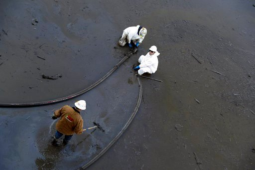 (AP Photo/Marcio Jose Sanchez). Crews pump mud out of southbound Highway 101 Saturday, Jan. 13, 2018, in Montecito, Calif.  Most of the people of Montecito, a town usually known for its serenity and luxury, were under orders to stay out of town as gas ...