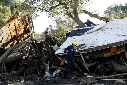 (AP Photo/Marcio Jose Sanchez). Search and rescue personnel scan a home in the aftermath of a mudslide Saturday, Jan. 13, 2018, in Montecito, Calif.  Most of the people of Montecito, a town usually known for its serenity and luxury, were under orders t...