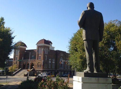 (AP Photo/Russell Contreras, File). FILE - In this Oct. 15, 2015, file photo, a statue of Rev. Martin Luther King, Jr. overlooks the 16th Street Baptist Church in Birmingham, Ala., where advocates say officials are doing a good job at preserving sites ...