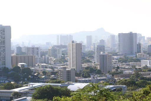 (AP Photo/Audrey McAvoy). Diamond Head, an extinct volcanic crater, and high-rises are seen in Honolulu on Saturday, Jan. 13, 2018. A push alert that warned of an incoming ballistic missile to Hawaii and sent residents into a full-blown panic was a mis...
