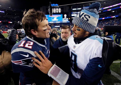 (AP Photo/Steven Senne). New England Patriots quarterback Tom Brady, left, and Tennessee Titans quarterback Marcus Mariota speak at midfield after an NFL divisional playoff football game, Saturday, Jan. 13, 2018, in Foxborough, Mass.