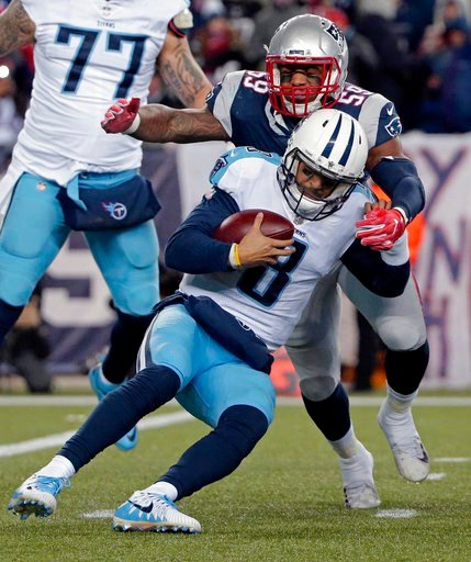 (AP Photo/Steven Senne). New England Patriots linebacker Marquis Flowers (59) sacks Tennessee Titans quarterback Marcus Mariota (8) during the second half of an NFL divisional playoff football game, Saturday, Jan. 13, 2018, in Foxborough, Mass.