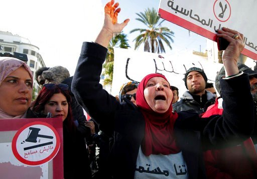 (AP Photo/Hassene Dridi). Family members of Tunisian who died in the revolution seven years ago, stage a protest in Tunis, Tunisia, Saturday, Jan. 13, 2018. European governments warned their citizens about potential rioting this weekend, when Tunisia m...