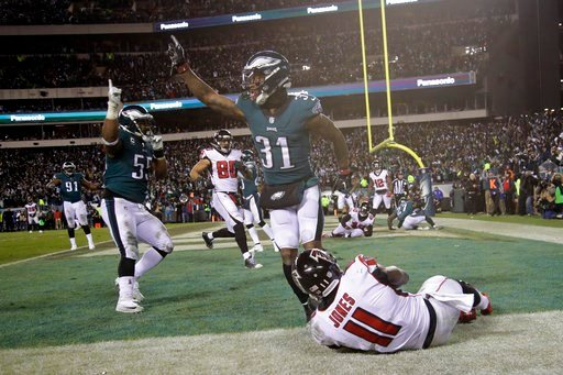 (AP Photo/Matt Rourke). Philadelphia Eagles' Jalen Mills (31) and Brandon Graham (55) celebrate after Atlanta Falcons' Julio Jones (11) cannot catch a fourth down pass during the second half of an NFL divisional playoff football game, Saturday, Jan. 13...