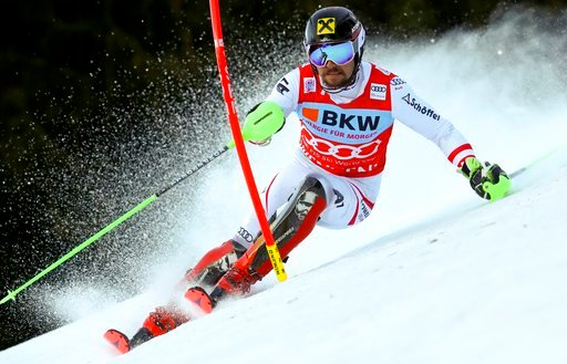 (AP Photo/Alessandro Trovati). Austria's Marcel Hirscher speeds down the course during an alpine ski, men's World Cup slalom in Wengen, Switzerland, Sunday, Jan. 14, 2018.