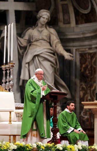 (AP Photo/Alessandra Tarantino). Pope Francis celebrates Mass on the occasion of the world day for migrants and refugees, in St. Peter's Basilica at the Vatican, Sunday, Jan. 14, 2018.