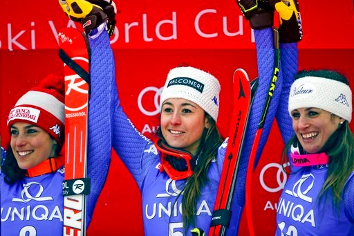 (AP Photo/Marco Trovati). Italy's Sofia Goggia, center, winner of an alpine ski, women's World Cup downhill, poses on the podium with second placed Italy's Federica Brignone, left, and third placed Italy's Nadia Fanchini, in Bad Kleinkirchheim, Austria...