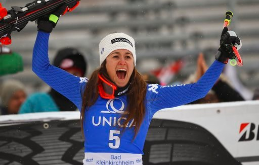 (AP Photo/Marco Trovati). Italy's Sofia Goggia celebrates after winning an alpine ski, women's World Cup downhill in Bad Kleinkirchheim, Austria, Sunday, Jan. 14, 2018.