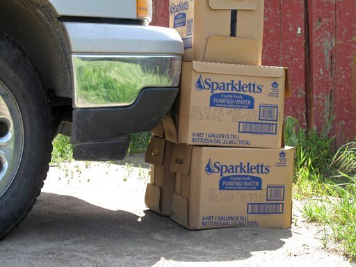 (AP Photo/Scott Smith, File). FILE - In this April 10, 2017 file photo, boxes of bottled drinking water are seen in Hardwick, a small community in the San Joaquin Valley, where drought has yet to loosen its grip on some residents near Hanford, Calif. R...