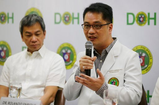(AP Photo/Aaron Favila). Department of Health Undersecretary Dr. Rolando Enrique Domingo, right, gestures besides Philippine General Hospital Director Dr. Gerardo Legaspi, during a press conference at the Department of Health office in Manila, Philippi...