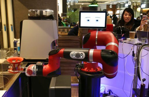 "(AP Photo/Koji Sasahara). Robot barista named ""Sawyer"" makes a coffee at Henn-na Cafe, Japanese meaning ""Strange Cafe""in Tokyo, Friday, Feb. 2, 2018. The cafe's robot barista brews and serves coffee as the rapidly aging country seeks to adapt to shrink..."