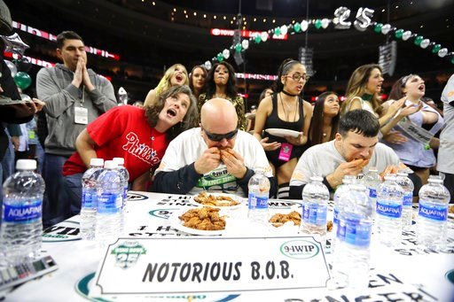 "(David Swanson/The Philadelphia Inquirer via AP, File). FILE - In this Friday, Feb. 3, 2017 file photo, Bob ""Notorious B.O.B."" Shoudt, left, takes part in the Wing Bowl in Philadelphia. Thousands of Philadelphia Eagles fans will be heading to a sports ..."
