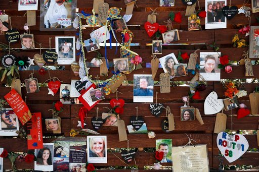(AP Photo/John Locher, file). FILE-In this Oct. 16, 2017, file photo,,photos and notes adorn a wall at the Las Vegas Community Healing Garden in Las Vegas. The garden was built as a memorial for the victims of the recent mass shooting in Las Vegas.