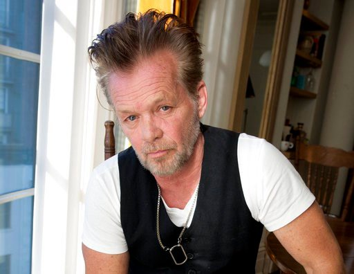 "(Photo by Amy Sussman/Invision/AP, File). FILE - In this Sept. 22, 2014 file photo, singer-songwriter John Mellencamp poses for a portrait to promote his 22nd album ""Plain Spoken"" at the Greenwich Hotel in New York. Just days before the Super Bowl, Joh..."