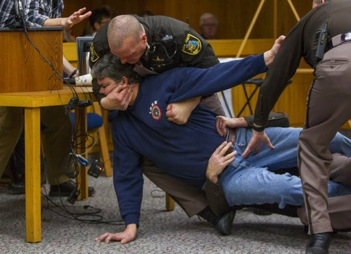 (Cory Morse/The Grand Rapids Press via AP). Eaton County Sheriff's deputies restrain Randall Margraves, father of three victims of Larry Nassar, Friday, Feb. 2, 2018, in Eaton County Circuit Court in Charlotte, Mich.  The incident came during the third...