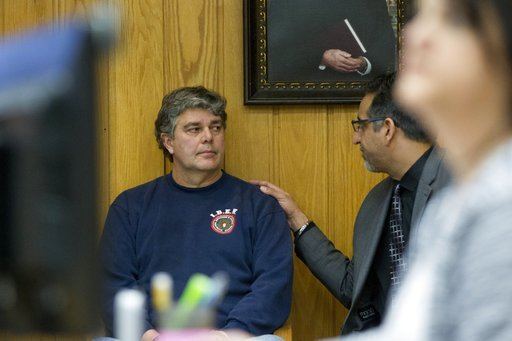 (Cory Morse/The Grand Rapids Press via AP). Randall Margraves, left, talks to attorney Mick Grewal, as he prepares to stand in front of Judge Janice Cunningham for a contempt of court hearing after he lunged at Larry Nassar during Nassar's sentencing a...