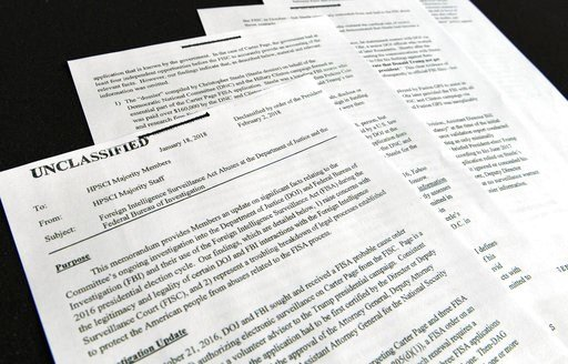 (AP Photo/Susan Walsh). A intelligence memo is photographed in Washington, Friday, Feb. 2, 2018. After President Donald Trump declassified the memo, the Republican-led House Intelligence Committee released it based on classified information that allege...