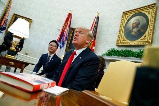 (AP Photo/Evan Vucci). President Donald Trump speaks with reporters about allowing the release of a secret memo on the FBI's role in the Russia inquiry, during a meeting with North Korean defectors in the Oval Office of the White House, Friday, Feb. 2,...