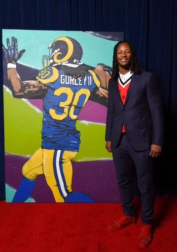 (Peter Barreras/NFL via AP). In this photo provided by the NHL, Todd Gurley of the Los Angeles Rams poses backstage with his portrait at the 7th Annual NFL Honors at the Cyrus Northrop Memorial Auditorium on Saturday, Feb. 3, 2018, in Minneapolis.