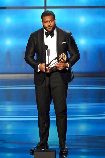 (Michael Zorn/NFL via AP). In this photo provided by the NFL, Aaron Donald of the Los Angeles Rams accepts the award for The Associated Press NFL Defensive Player of the Year presented by Old Spice at the 7th Annual NFL Honors at the Cyrus Northrop Mem...