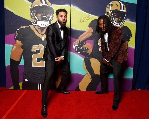 (Peter Barreras/NFL via AP). In this photo provided by the NFL, Marshon Lattimore, left, and Alvin Kamara, of the New Orleans Saints pose backstage with their portraits at the 7th Annual NFL Honors at the Cyrus Northrop Memorial Auditorium on Saturday,...