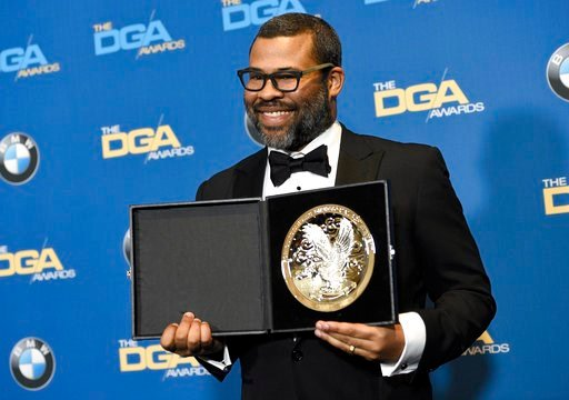 "(Photo by Chris Pizzello/Invision/AP). Jordan Peele poses in the press room with a medallion honoring his nomination for outstanding directorial achievement in a feature film for ""Get Out"" at the 70th annual Directors Guild of America Awards at The Bev..."
