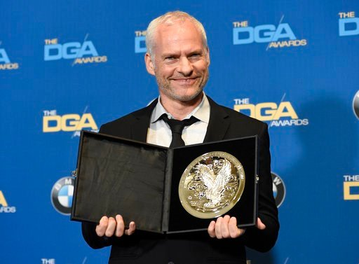 "(Photo by Chris Pizzello/Invision/AP). Martin McDonagh poses in the press room with a medallion honoring his nomination for outstanding directorial achievement in a feature film for ""Three Billboards Outside Ebbing, Missouri"" at the 70th annual Directo..."