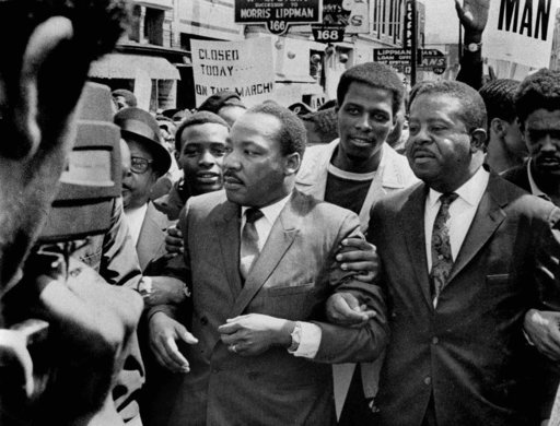 (Sam Melhorn/The Commercial Appeal via AP). FILE-In this March 28, 1968, file photo, Dr. Martin Luther King Jr. and Rev. Ralph Abernathy, right, lead a march on behalf of striking Memphis, Tennessee., sanitation workers. Fifty years ago, two sanitation...