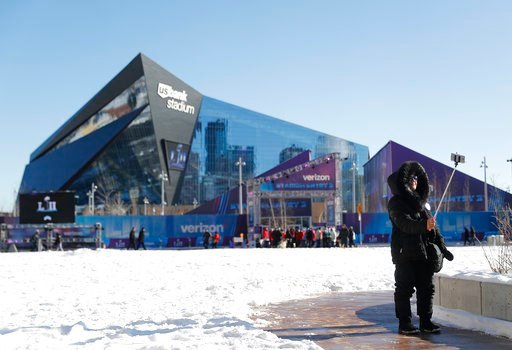(AP Photo/Jeff Roberson). Beno Naeunan takes a selfie outside U.S. Bank Stadium before the NFL Super Bowl 52 football game between the Philadelphia Eagles and the New England Patriots Sunday, Feb. 4, 2018, in Minneapolis.