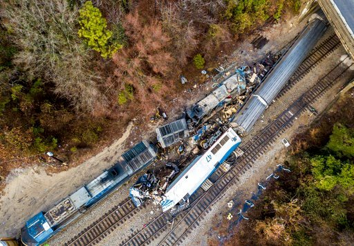 (AP Photo/Jeff Blake). An aerial view of the site of an early morning train crash Sunday, Feb. 4, 2018 between an Amtrak train, bottom right, and a CSX freight train, top left, in Cayce, SC. The Amtrak passenger train slammed into a freight train in th...