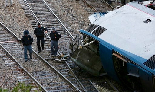 (Tim Dominick/The State via AP). Authorities investigate the scene of a fatal Amtrak train crash in Cayce, South Carolina, Sunday, Feb. 4, 2018. At least two were killed and dozens injured.
