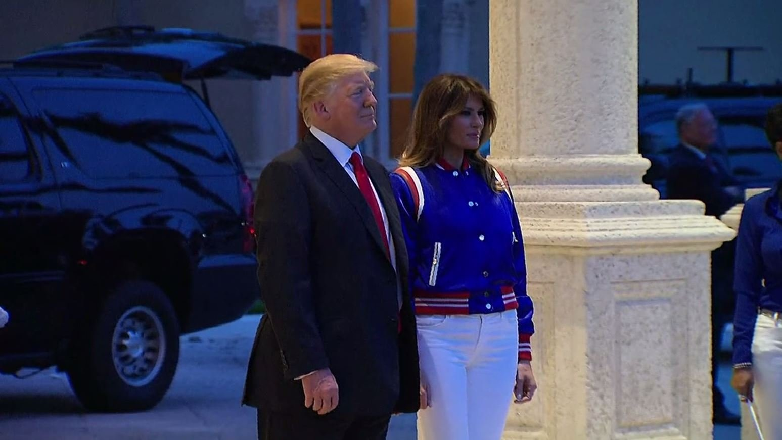 President Donald Trump and first lady Melania Trump watch as the Florida Atlantic University Marching Band welcomes the president to his private golf club in West Palm Beach, Florida, where he hosted a Super Bowl watch party. (Source: CNN)