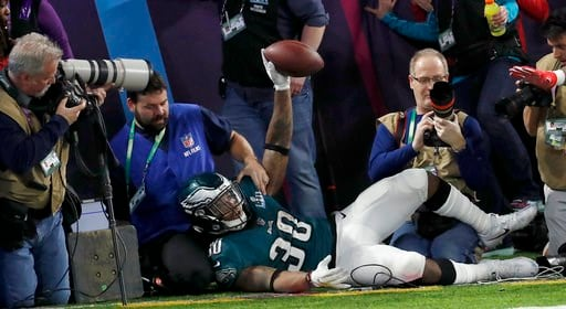 (AP Photo/Matt York). Philadelphia Eagles' Corey Clement crashes into photographers after catching a touchdown pass during the second half of the NFL Super Bowl 52 football game against the New England Patriots Sunday, Feb. 4, 2018, in Minneapolis.