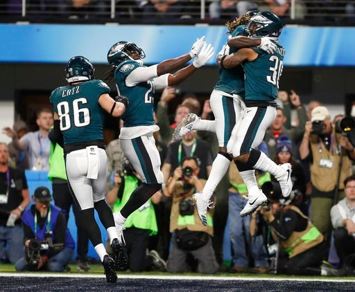 (AP Photo/Jeff Roberson). Philadelphia Eagles' Corey Clement, right, celebrates his touchdown catch during the second half of the NFL Super Bowl 52 football game against the New England Patriots Sunday, Feb. 4, 2018, in Minneapolis.