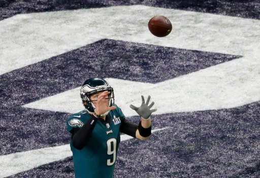 (AP Photo/Eric Gay). Philadelphia Eagles quarterback Nick Foles catches a touchdown pass against the New England Patriots during the first half of the NFL Super Bowl 52 football game Sunday, Feb. 4, 2018, in Minneapolis.
