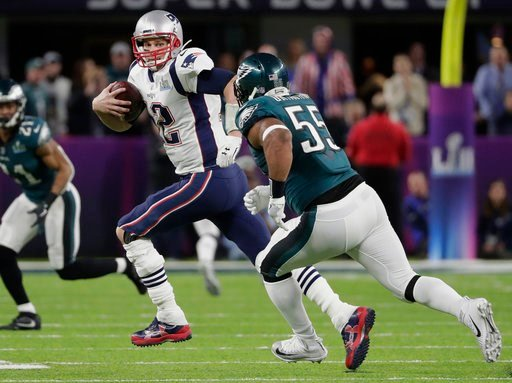 (AP Photo/Tony Gutierrez). New England Patriots quarterback Tom Brady (12) scrambles against Philadelphia Eagles defensive end Brandon Graham (55), during the first half of the NFL Super Bowl 52 football game, Sunday, Feb. 4, 2018, in Minneapolis.