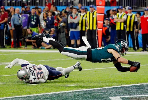 (AP Photo/Charlie Neibergall). Philadelphia Eagles tight end Zach Ertz (86) dives into the end zone over New England Patriots free safety Devin McCourty (32) for a touchdown, during the second half of the NFL Super Bowl 52 football game against the New...
