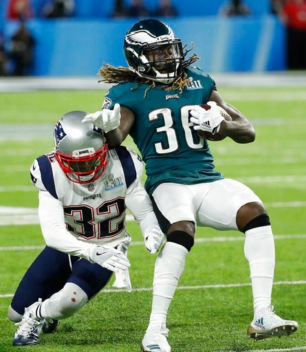 (AP Photo/Matt York). Philadelphia Eagles' Jay Ajayi, right, tries to get away from New England Patriots' Devin McCourty during the first half of the NFL Super Bowl 52 football game Sunday, Feb. 4, 2018, in Minneapolis.