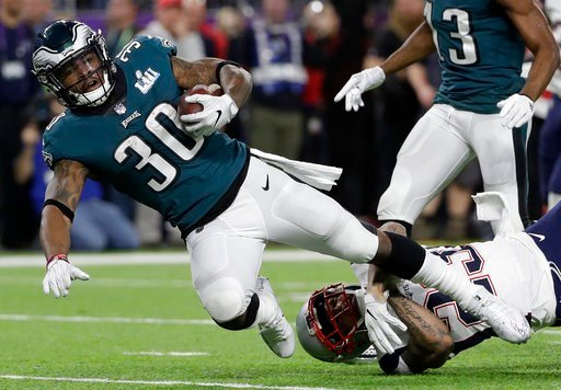 (AP Photo/Matt Slocum). Philadelphia Eagles' Corey Clement is stopped by New England Patriots' Patrick Chung after catching a pass during the first half of the NFL Super Bowl 52 football game Sunday, Feb. 4, 2018, in Minneapolis.