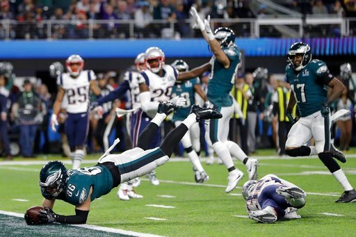 (AP Photo/Mark Humphrey). Philadelphia Eagles' Zach Ertz dives into the end zone for a touchdown during the second half of the NFL Super Bowl 52 football game against the New England Patriots Sunday, Feb. 4, 2018, in Minneapolis.