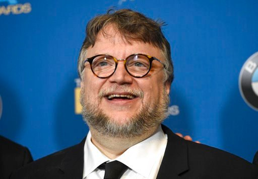 """(Photo by Chris Pizzello/Invision/AP). Guillermo del Toro, winner of the award for outstanding directorial achievement in a feature film for """"The Shape of Water,"""" poses in the press room at the 70th annual Directors Guild of America Awards at The Bever..."""