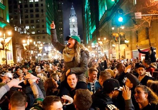 (AP Photo/Matt Rourke). Philadelphia Eagles fans celebrate the team's victory in the NFL Super Bowl 52 between the Philadelphia Eagles and the New England Patriots, Sunday, Feb. 4, 2018, in downtown Philadelphia.