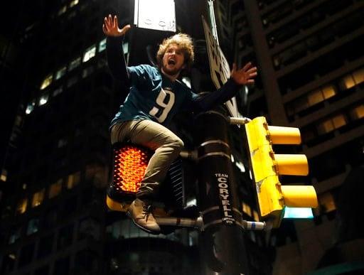 (AP Photo/Matt Rourke). A Philadelphia Eagles fan celebrates the team's victory in the NFL Super Bowl 52 between the Philadelphia Eagles and the New England Patriots, Sunday, Feb. 4, 2018, in downtown Philadelphia.