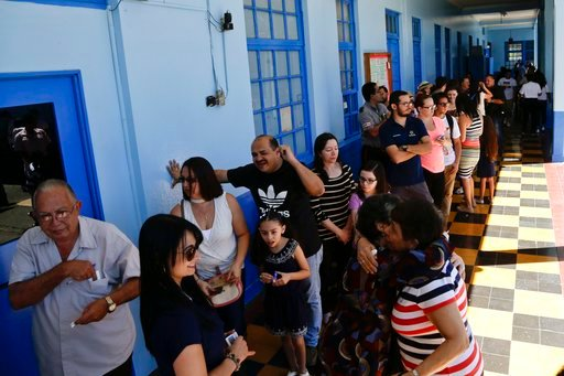 (AP Photo/Arnulfo Franco). Voters are seen at a polling station during presidential election in San Jose, Costa Rica, Sunday, Feb. 4, 2018. Costa Rica will hold general elections on Sunday, Feb. 4. Costa Ricans voted Sunday in a presidential race shake...